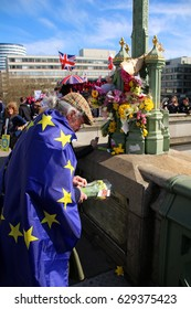 LONDON, ENGLAND, 25 MARCH 2017: Mourners pay their respects to the victims of a terror attack in London. Westminster Bridge was the scene of a terror attack that left 5 dead & 50 injured. Editorial.