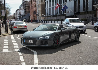 London, England - 25.03.17: a grey Audi R8 Spyder supercar is turning to one of the streets in Knightsbridge district. Supercars like this Audi are very common on the streets of central London.
