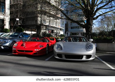 London, England - 25.03.17: two legendary supercars, Ferrari F50 (left) and Porsche Carrera GT (right) parked outside the Dorschester Hotel in Mayfair. Only 1270 Porsches were made and 349 of Ferrari.