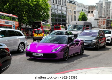 London, England - 25.06.17: a Ferrari 488 GTB supercar in purple wrap in traffic at central London. The capital of England is full of colourful sports cars, which stand out in traffic.