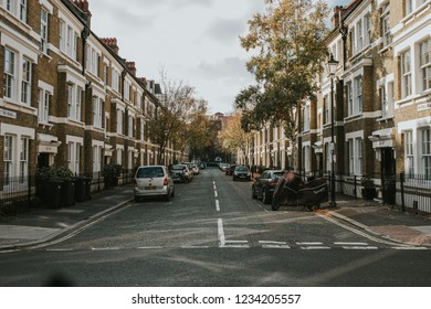 LONDON, ENGLAND - 25th October, 2018: Perspective of Mitre Road, in Waterloo neighbourhood, with residential houses and cars parked, in London city, England.