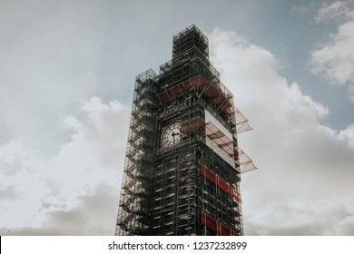 LONDON, ENGLAND - 25th October, 2018: Big Ben clock with Scaffolds, during restoration works, with sun and clouds in the background, in London, England.