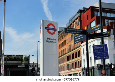 LONDON, ENGLAND- 27 SEPTEMBER 2013: A sign displaying the London Overground Sign and the guidepost at the entrance to Shoreditch High Street Station, London, England, UK
