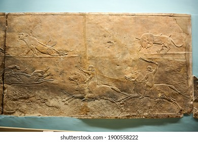 London England; 29,08,2015: plaster bas-relief in the palace of Nineveh showing the royal hunting of lions in Assyria