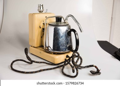 London, England, 29/11/19 Hawkins Tecal on Alarm clock from the 1930's 1950's in Britain that boils a kettle for you when you wake up. Genius invention unused any more shot professionally on white