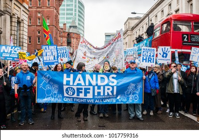 London, England. 3rd Feb 2018. EDITORIAL. Protesters holding HANDS OFF HRI banner at the NHS In Crisis demonstration through central London, in protest of underfunding & privatisation of the NHS.