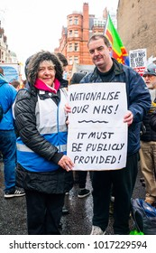 London, England. 3rd February 2018. EDITORIAL - Man and woman jointly holding a poster at the NHS In Crisis demonstration through central London, in protest of underfunding & privatisation of the NHS.
