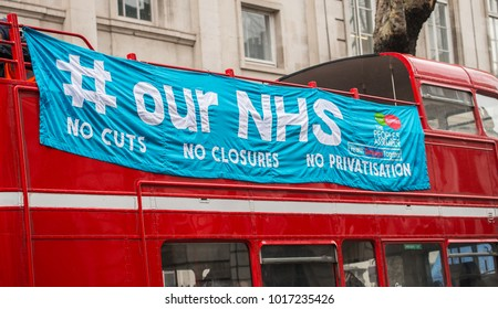 London, England. 3rd February 2018. EDITORIAL - Large # our NHS banner on side of bus at the NHS In Crisis demonstration through central London, in protest of underfunding & privatisation of the NHS.