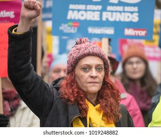 London, England. 3rd February 2018. EDITORIAL - Woman protester with clenched fist at the NHS In Crisis demonstration through central London, in protest of underfunding & privatisation of the NHS.