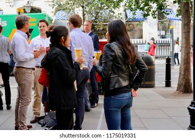 London, England- 4 August 2017: People having beer at the street.