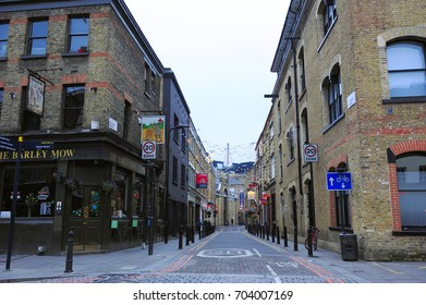 LONDON, ENGLAND- 4 JANUARY 2015: The alley way between the old brick buildings in Shoreditch High Street.  It is the north-eastern corner of the City of London, England, UK