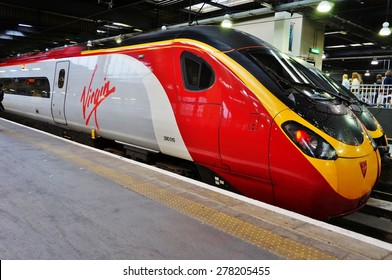 LONDON, ENGLAND -8 JULY 2014- Virgin trains to Coventry and Birmingham leave London from the Euston Station.