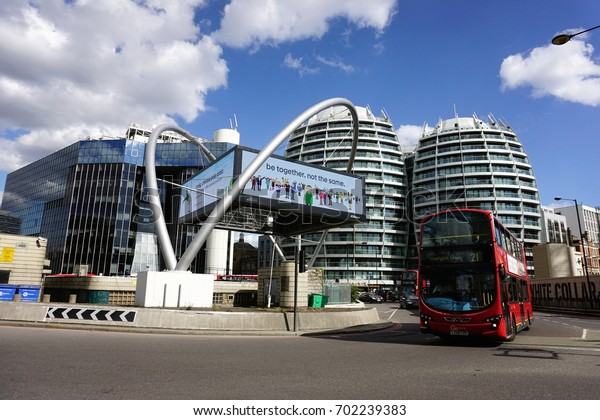 LONDON, ENGLAND- 9 MAY 2015: View of  Red double decker London bus and Tech City London around Old Street station underneath the blue sky. It is the north-eastern corner of the City of London