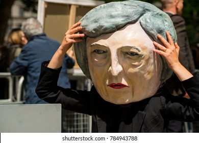 London, England. 9th June 2017. EDITORIAL - Woman wearing a full head mask of PM Theresa May, stages an anti-government / Hard Brexit protest in Whitehall outside Downing Street, London, UK.