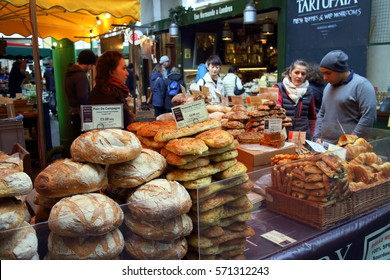 London, England - April 02, 2015: Bread and pastries on display at a bakery stall in Borough Market, London. A market has traded in the London Borough of Southwark for more than 250 years