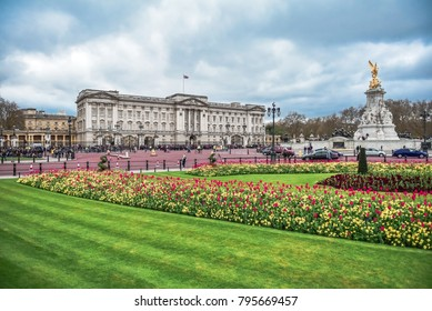 LONDON, ENGLAND - APRIL 03, 2017:    Beautiful Green Park and floral arrangements in front of Buckingham Palace in London.