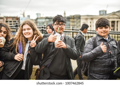 LONDON, ENGLAND - APRIL 07, 2017: People visit Thames Embankment in London, UK. London is the most populous city in the UK with 13 million people living in its metro area. Street view, United Kingdom