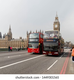 LONDON, ENGLAND - April 10, 2015: Tour buses on Westminster bridge with the famous Big Ben in the background