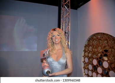 LONDON, ENGLAND - APRIL 12, 2017: wax figure of pop music singer, Britney Jean Spears with an MTV award. A museum to enjoy with your family the many famous people.