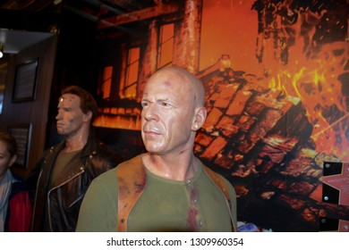 LONDON, ENGLAND - APRIL 12, 2017: wax figure of famous Hollywood actor Bruce Willis, known for his action movies. A museum to enjoy with your family the many famous people.