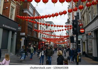 London, England - April 13, 2017: Famous Chinatown located in Soho, inside the city of Westminster. Its streets adorned with lanterns and many typical Chinese objects