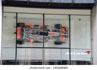 London, England - April 14, 2017: the McLaren showroom in Knightsbridge. Main entrance, with a Formula 1 car at the top, similar to the one driven by the driver Lewis Hamilton