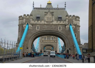 London, England - April 14, 2017: Front view of the entrance to the Tower Bridge. Famous bridge that crosses the River Thames