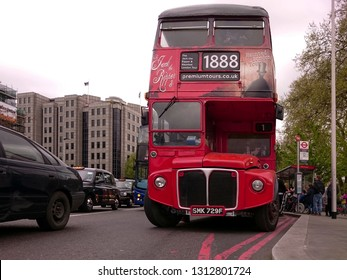 London, England - April 14, 2017: Front part of the red  Routemaster bus RML2729, put into operation in 1967. Currently belongs to Premium Tours, which uses it in the tourist services of London.