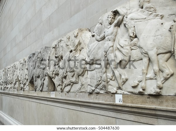 London, England - April 17, 2014. Section of a frieze from the Elgin Marbles or Parthenon Marbles, inside the British Museum in London.