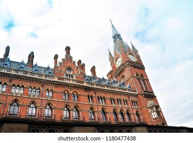 London, England - April 17 2017: Facade of the St. Pancras Renaissance London Hotel. Clock tower stands at 82m tall. Former Midland Grand Hotel designed by George Gilbert Scott.