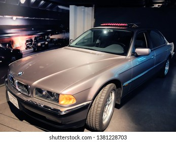 """London, England - April 18, 2014. A BMW 750iL used in the film """"Tomorrow Never Dies"""" seen in an exhibition of James Bond cars in London."""