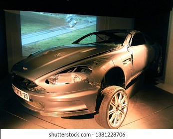 """London, England - April 18, 2014. A crashed Aston Martin DBS used in the film """"Casino Royale"""" seen in an exhibition of James Bond cars in London."""