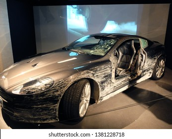 """London, England - April 18, 2014. A damaged Aston Martin DBS used in the film """"Quantum of Solace"""" seen in an exhibition of James Bond cars in London."""