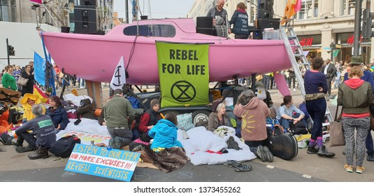 London, England, April 18th, 2019: Extinction Rebellion climate activists block traffic on Oxford Street London, as part of a series of protests around Central London.