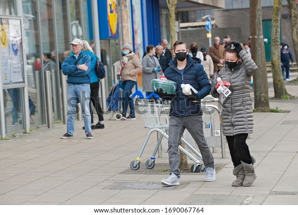 London, England. April 1st, 2020. People out shopping in South London during the Coronavirus pandemic. Wearing protective mask and practising social distancing.