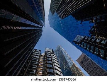 London, England, April 2019: high office buildings in central skyline of the City  seen from the street up to the sky