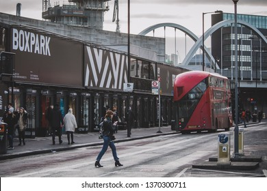 London / England - April 2019 - wide shot of container park BOXPARK in Shoreditch with a red bus on the street
