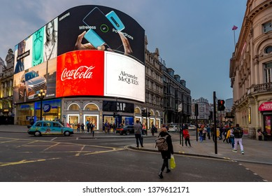 London, England, April 21, 2019: Piccadilly Circus at twilight with the huge billboards behind.