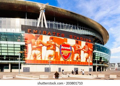LONDON, ENGLAND - APRIL 22ND: Visitors on the outside of The Emirates Stadium, Arsenal Football Club. Hornsey Rd, London, N7 7AJ. England. 22ND April 2010