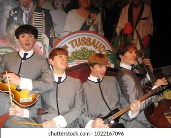 London, England - April 24, 2008. The Beatles band wax figures inside the Madame Tussauds wax museum.
