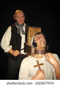 London, England - April 24, 2008. Representation of torturing a man on a torture chair during inquisition, inside the Madame Tussaud wax museum.
