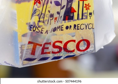 London, England - April 24, 2015: Person Holding a Tesco Carrier Bag, Tesco is a worldwide supermarket chain first founded in 1919