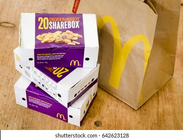 London, England - April 25, 2014: Box of McDonald's Chicken McNuggets, McDonald's is a fast food restaurant chain founded in 1940.