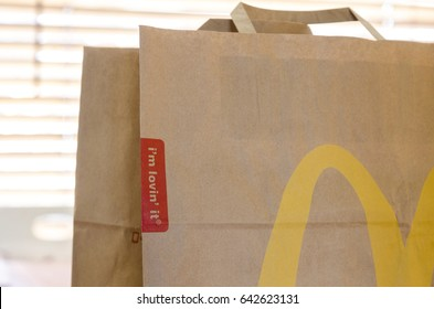 London, England - April 25, 2014: Close up of a McDonald's Take Away Food Brown Paper Bag,  McDonald's is a fast food restaurant chain founded in 1940.