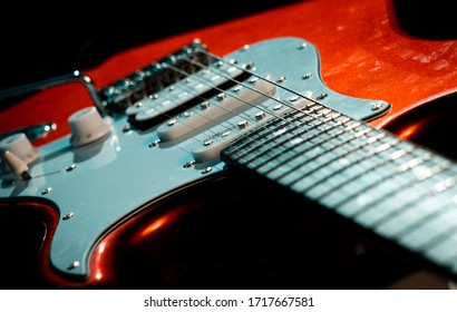 London, England - April 25, 2020: Detail of a Red Stratocaster Design Copy Electric Guitar, Electric guitars were first invented around the 1930s