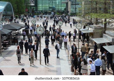 London, England, April 26th 2018: Office workers in the Canary Wharf financial district in London.