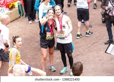 London, England – April 28, 2019: Actors Helen Skelton and Cel Spellman present their medals after crossing the finish line during the Virgin Money London Marathon.