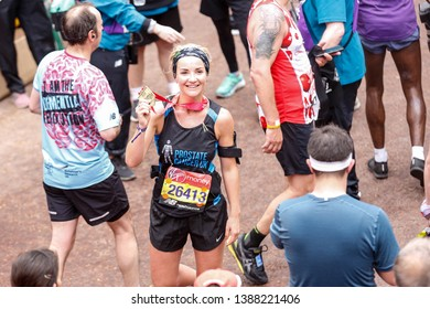 London, England – April 28, 2019: An actress, Helen Skelton presents her medal after crossing the finish line during the Virgin Money London Marathon.