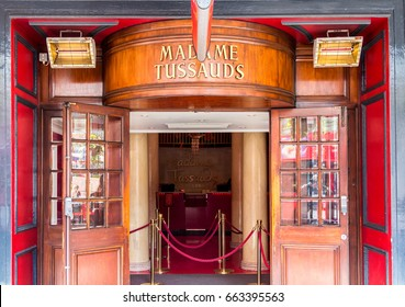 London, England - April 3, 2017: Entrance of Madame Tussaud's museum with brass ensign and wooden door.