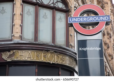 LONDON, ENGLAND - APRIL 30:. Exterior of Harrods department store with Underground Sign in London on April 30, 2017